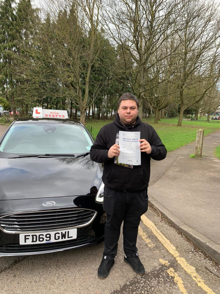 Picture of Joe Holub after his test pass, displaying his pass certificate.